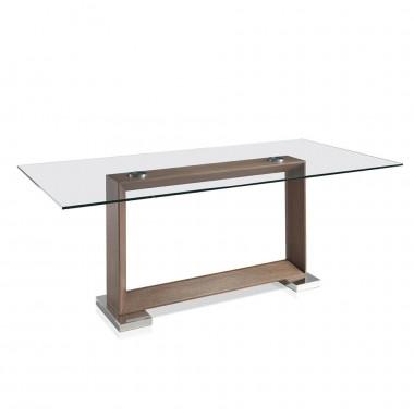 Mesa de comedor rectángular de cristal templado y pata de madera de nogal.