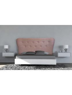 Cabecero de cama de matrimonio tapizado con botones capitone.