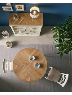 Mesa de comedor extensible redonda u ovalada lacada en blanco y con tablero de madera roble.