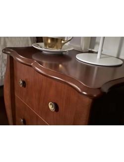 Mesilla de dormitorio de madera con tres cajones en cerezo, nogal o lacada blanca.