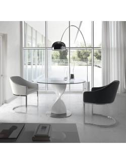 Mesa de comedor redonda con tapa de cristal templado y pie central de fibra de vidrio.