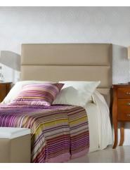Cabecero tapizado en polipiel para camas de 90, 105, 135 y 150 cm.